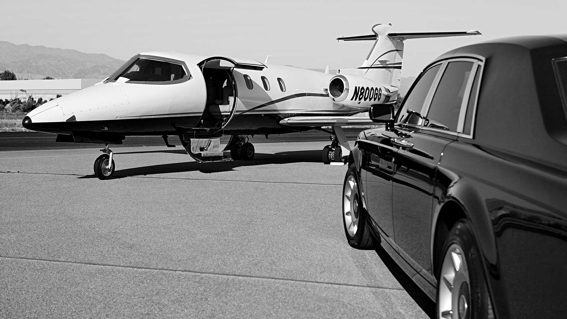 Airport Pick-up Limousine Service (black limo)